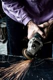 Industrial worker using a small grinder for cutting metal Royalty Free Stock Photos