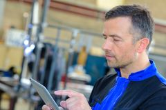 Industrial worker using tablet stock photography