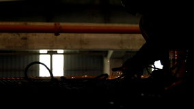 Industrial worker welding and bright sparks Royalty Free Stock Images