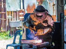 Industrial worker welding. Electric welding work Stock Photography