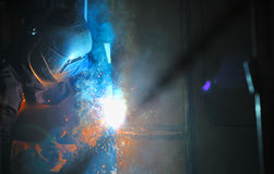 Industrial worker welding in factory Stock Images