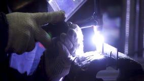 Industrial worker welding, slow motion. Clip. Metal Welding Close-Up in super slow motion. Close-up. Welder in royalty free stock image