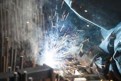 Industrial worker welding. Steel in the dark Stock Photos