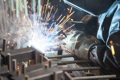 Industrial worker welding. Steel in the dark Stock Photo