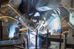 Industrial worker welding. Steel in the dark Stock Images