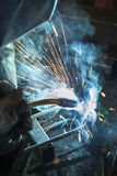 Industrial worker welding Stock Images