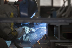 Industrial worker welding. Steel in the dark Royalty Free Stock Photo