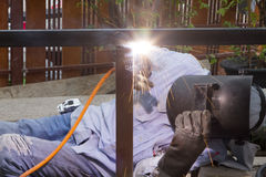 Industrial worker welding steel pipe flange Stock Photo