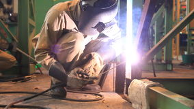 Industrial worker welding steel structure. stock video footage