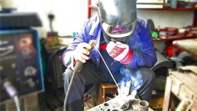 Industrial worker welding stock video footage