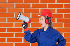 Industrial worker woman with a megaphone Stock Photos