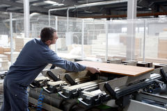 Industrial worker in wood factory royalty free stock photo