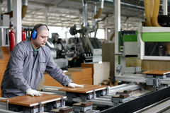 Industrial worker - wood and furniture factory royalty free stock images