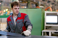 Industrial worker working in factory workshop Stock Images
