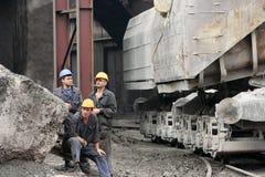 Industrial workers having a smoking break Royalty Free Stock Photos