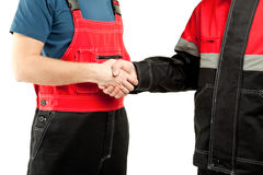 Industrial workers in uniform shake hands Royalty Free Stock Photography