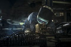 Industrial workers are welding steel parts automotive. stock images