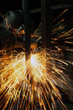 Industrial working of grinding sparks with worker Stock Photo