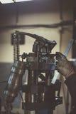 Industrial workshop bending pipe press machine. Operator stock photography