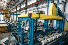 Industrial workshop for thermal insulation sandwich panel production line for construction, machine tools, roller conveyor. Industrial manufactory workshop for royalty free stock images