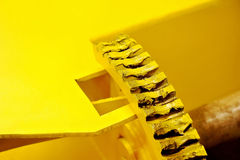 Industrial yellow gear with grease Royalty Free Stock Images