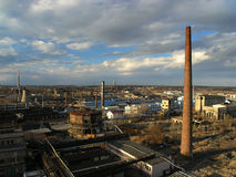 Industrial zone. With many chimneys. Dramatic clouds Stock Images