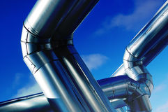 Industrial zone. Steel pipe-lines on blue sky Royalty Free Stock Images