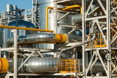 The equipment of oil refining. Industrial zone,The equipment of oil refining,Close-up of industrial pipelines of an oil-refinery plant,Detail of oil pipeline stock images