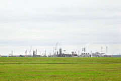 Industrial zone with factories and pipes with smoke Stock Photo