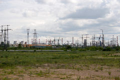 Industrial zone and green field Royalty Free Stock Photos