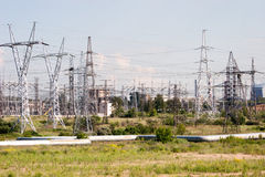 Industrial zone and green field Royalty Free Stock Photo