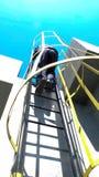 Industrial zone, man climbing staircase Royalty Free Stock Photos
