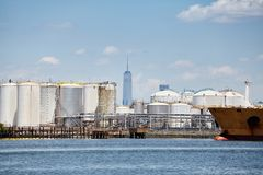 Industrial zone with New York skyscraper in distance, USA.  stock photos