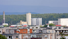 Industrial zone in small mountain town Stock Photos