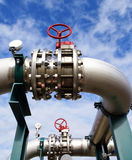 Industrial zone, Steel pipe-lines on blue sky Royalty Free Stock Images