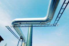 Industrial zone, Steel pipe-lines on blue sky Royalty Free Stock Photo