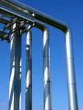 Industrial zone, steel pipelines on blue sky. Industrial view, steel pipelines on blue sky Stock Image