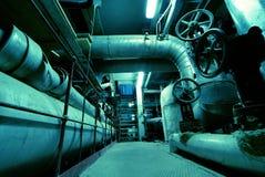 Industrial zone, Steel pipelines in blue tones Royalty Free Stock Images