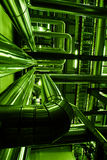 Industrial zone Steel pipelines in green tones Royalty Free Stock Photo