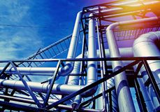 Industrial Steel pipelines and valves against blue sky Royalty Free Stock Images