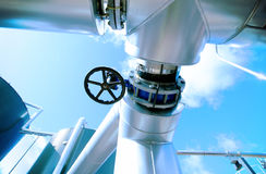 Industrial zone, Steel pipelines  valves against blue sky Royalty Free Stock Photography