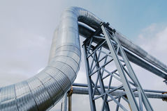 Industrial zone, Steel pipelines and valves against blue sky Stock Photos