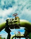 Industrial zone, Steel pipelines and valves against blue sky Royalty Free Stock Photography
