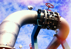 Industrial zone, Steel pipelines and valves against blue sky Royalty Free Stock Images