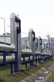 Industrial zone, Steel pipelines and valves against blue sky Stock Image
