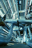 Industrial zone, Steel pipelines, valves and cables Royalty Free Stock Photography