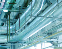 Industrial zone, Steel pipelines, valves and cables Royalty Free Stock Photos