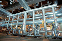 Industrial zone, Steel pipelines, valves and cables Stock Photos