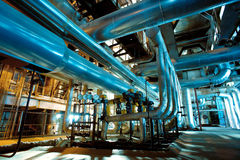 Industrial zone, Steel pipelines, valves and cables Royalty Free Stock Images