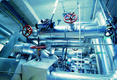 Industrial zone, Steel pipelines and valves Stock Photos